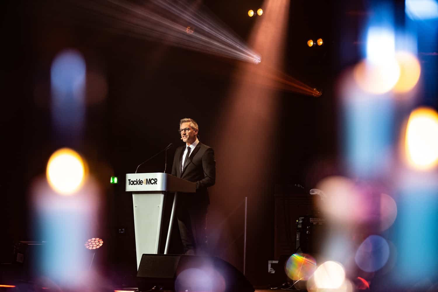 Corporate and conference photographer based in manchester this is gary linkaer presenting at the tackle for manchester awards in 2019