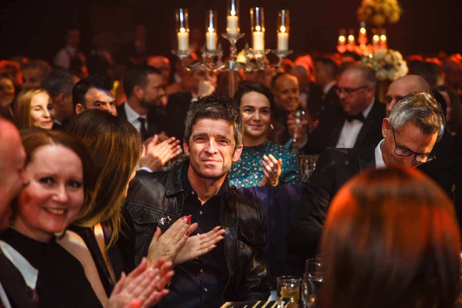 noel gallagher at an event in manchester full of celebrities