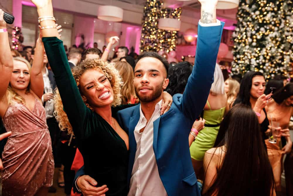 people having fun with hands in the air at a party in manchester taken by er event photography