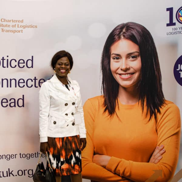 delegate having her photo taken at a conference