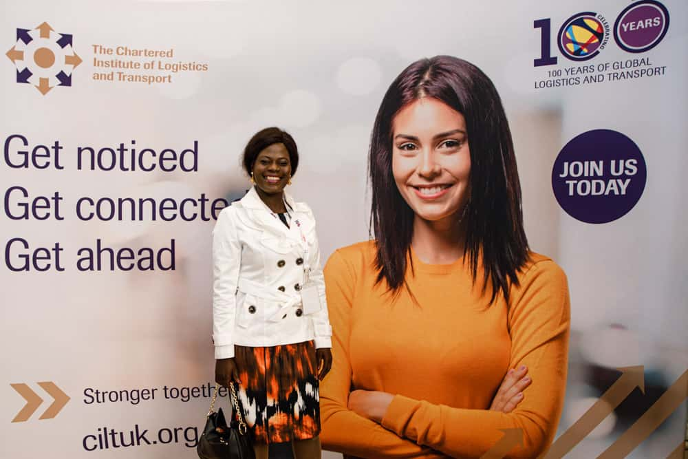 delegate having her photo taken at a conference
