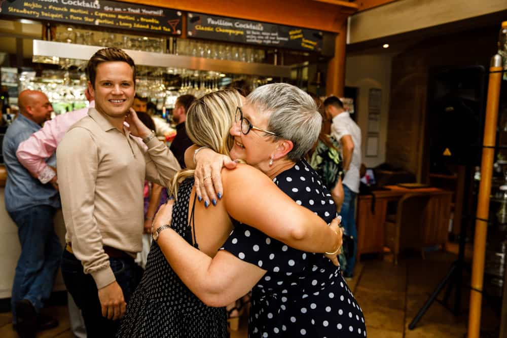 a hug at debbies 60th birthday