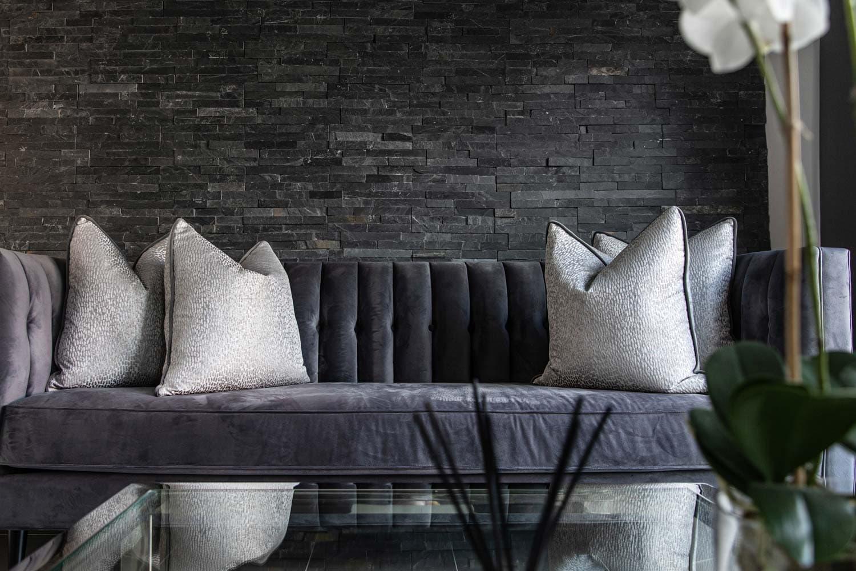 Interior property photography purple velvet sofa and cushions