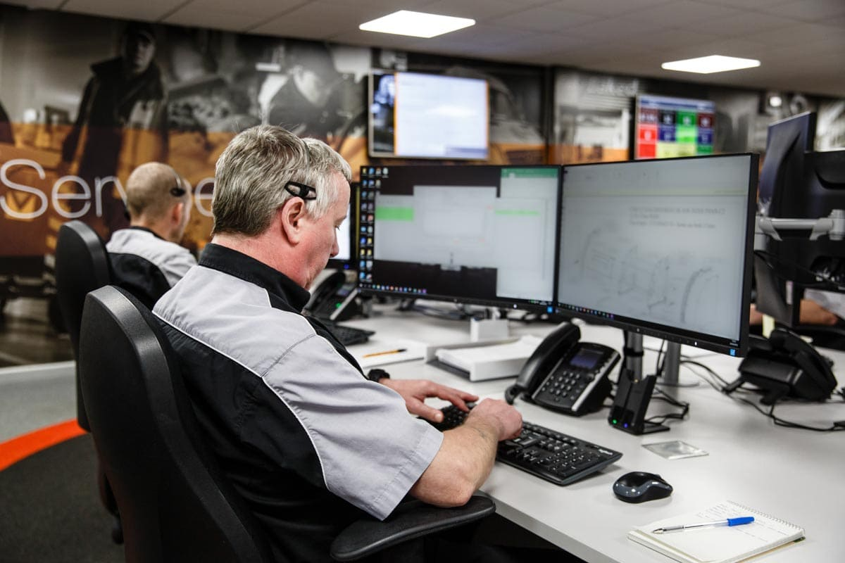 Commercial Photographer Manchester photo of staff on live help desk