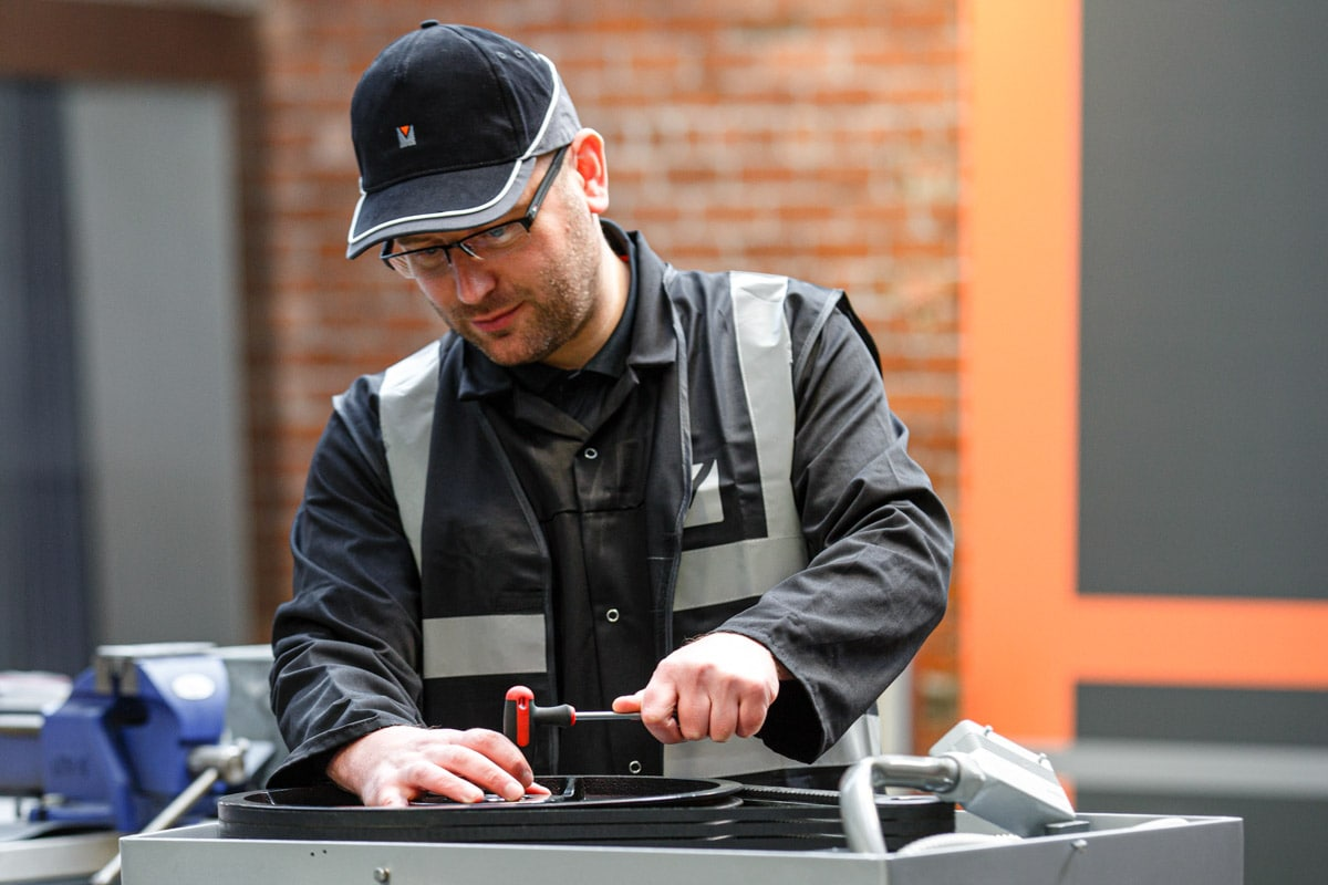 Commercial Photographer Manchester photo of man fixing machines