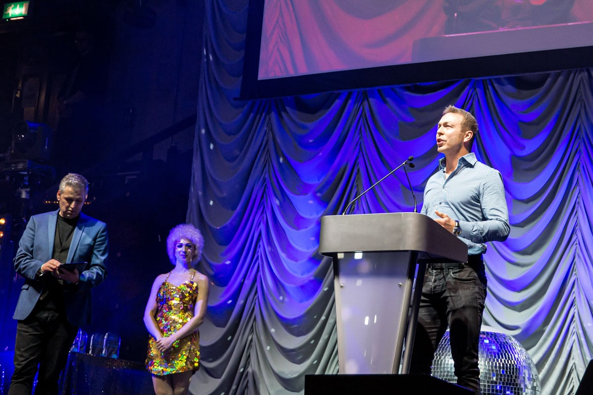 presenting an award at a conference is chris moys