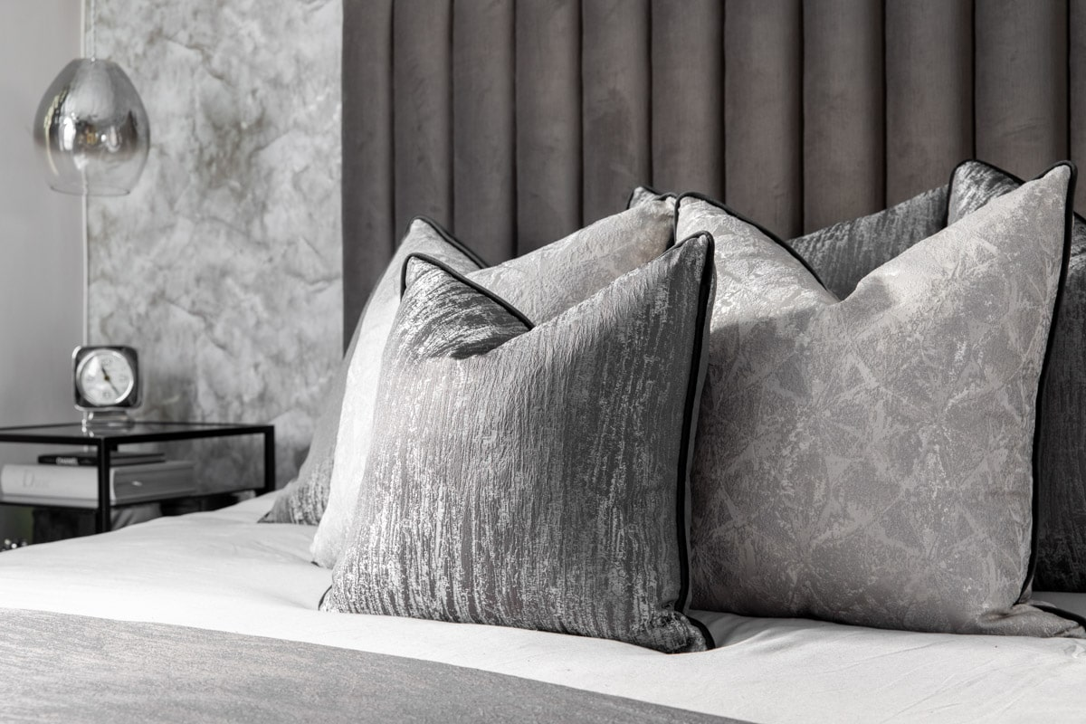 cushions on the bed displayed